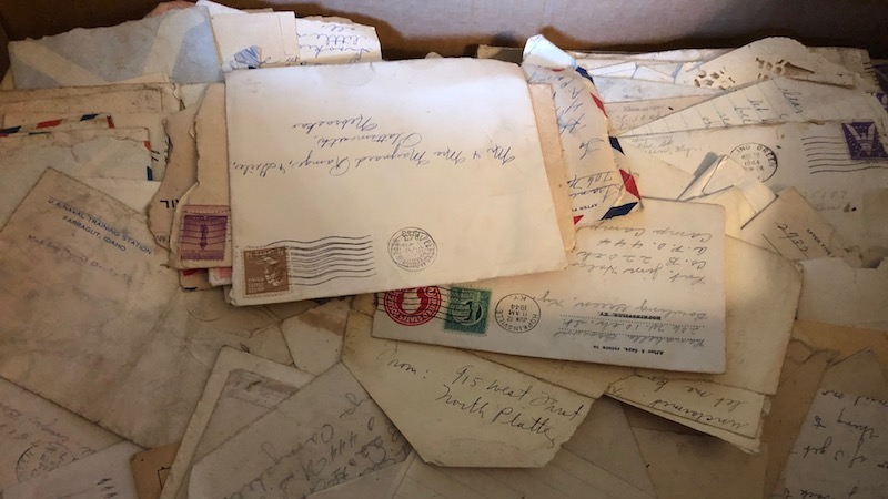 Letters and envelopes randomly scattered in a box